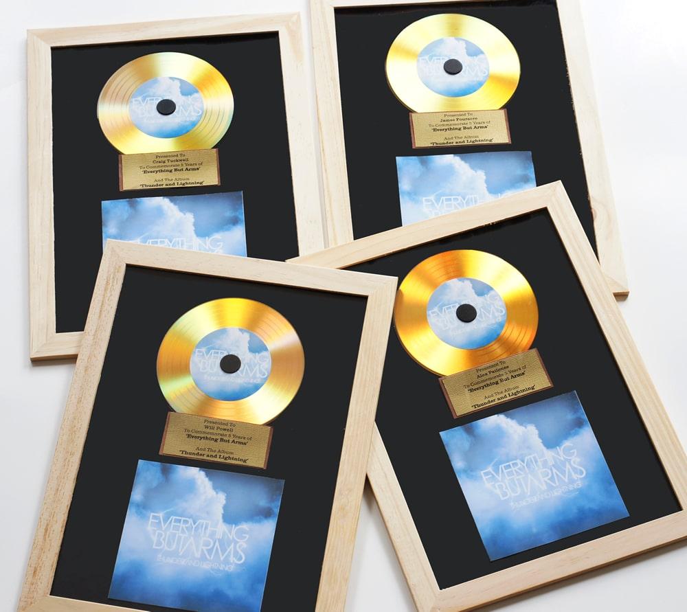 Gold vinyl CDs in an award mount