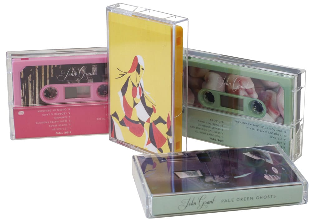 A set of three different colour cassettes in baby pink, yellow and sage green