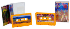 Orange cassettes with full colour stickers and printed cases