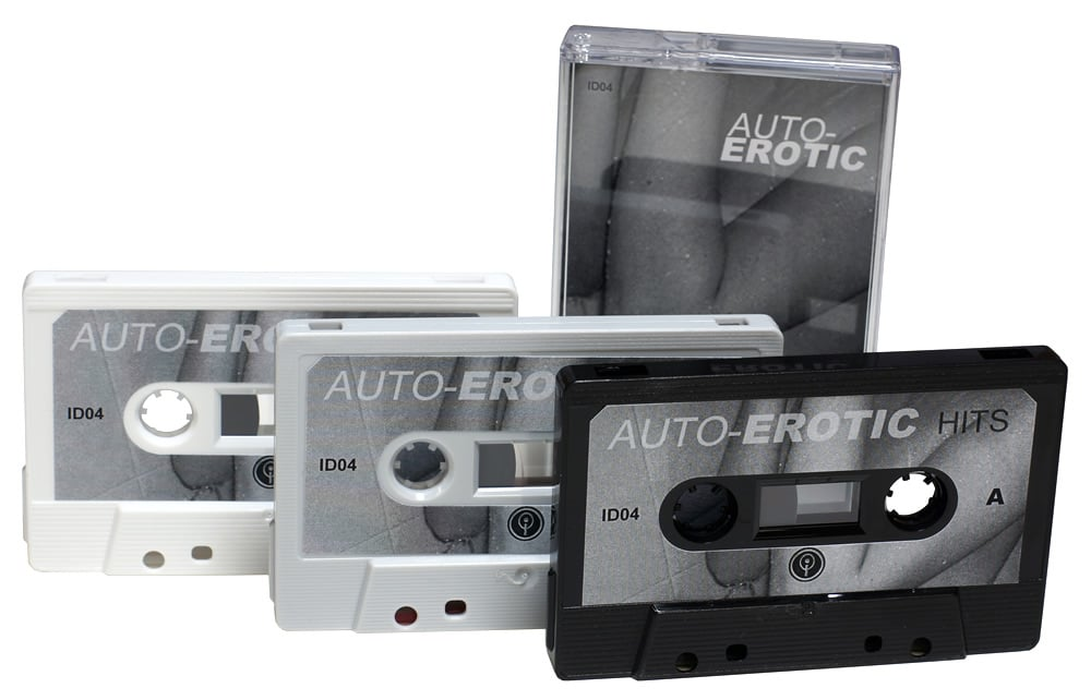 White, grey and black cassettes with black and white sticker printing and matching J-cards