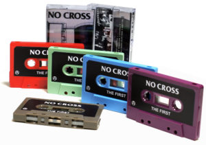 Red, sage green, baby blue, blackberry purple and cocoa brown cassettes with black and white sticker printing and matching J-cards
