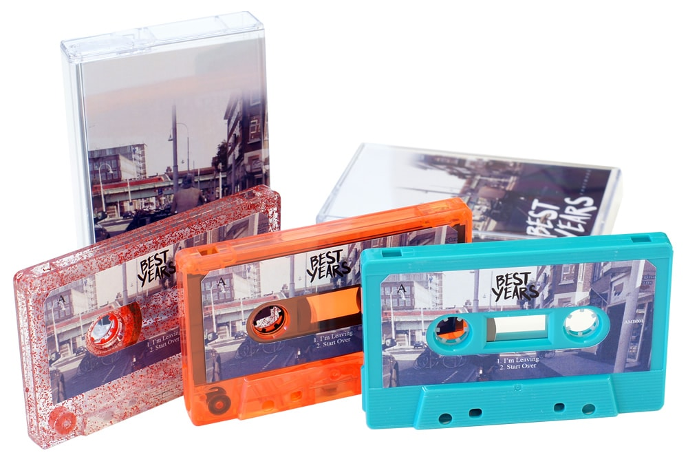 A set of red glitter, orange transparent and turquoise cassettes