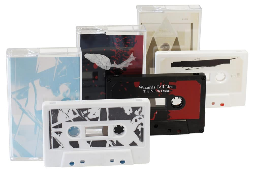 A set of three different cassettes with printed J-card inserts