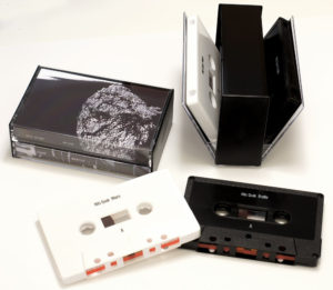 Black and white cassettes with on-body print in double butterfly cases