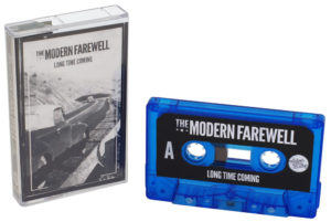 A set of blue transparent cassettes with printed J-card inserts