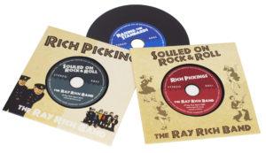 Set of 3 vinyl CDs in printed card wallets