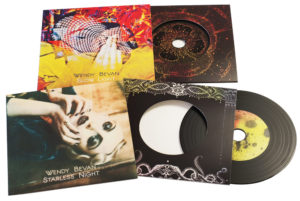 Set of 2 vinyl CDs in printed card wallets with a larger outer printed wallet and finished with cellophane wrapping