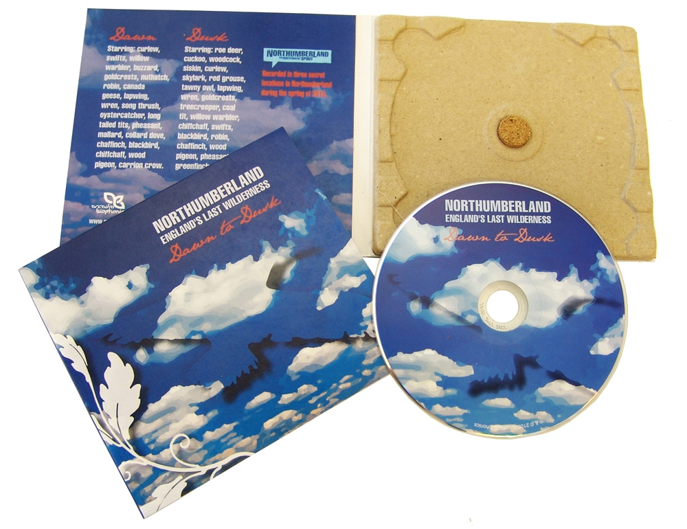 A replicated 100% recycled card eco digipak with a disc tray made from recycled egg boxes and a cork disc stud