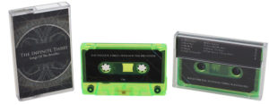 A set of green transparent cassettes with sticker printing in printed jewel cases