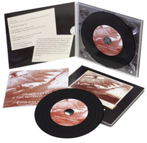 Vinyl CD in digipak & recycled 16 page booklets