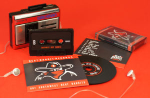A matching set of black cassettes in black back cassette cases, plus black vinyl CDs in standard card wallets