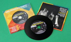 Black vinyl CDs in record-style printed card wallets