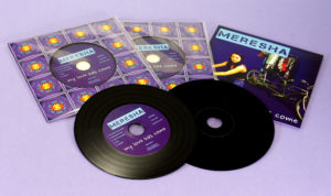 Black vinyl CDs in record-style card wallets with a cellophane wrap