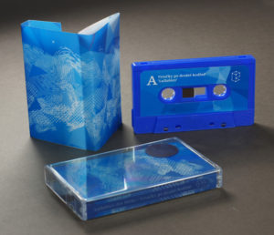 Sharmi blue cassettes with full colour stickers and tracing paper semi-transparent multi panel J-cards printed on one side