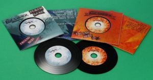 Black vinyl CD double release in printed card wallets