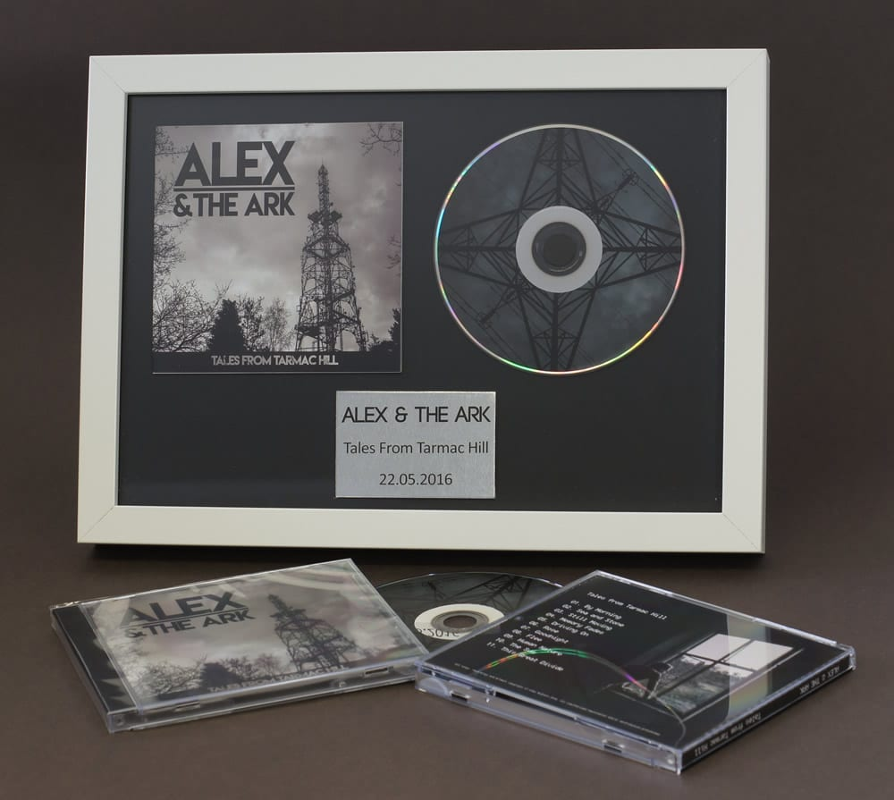 CD booklet and 12cm disc in presentation frame