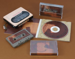 A set of cocoa brown cassettes in cases with J-cards and matching CDs in our 100% recycled eco digipaks