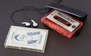 Cream cassette cases combined with cream J-cards and cassette stickers, plus a vibrant transparent orange cassette