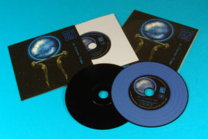 A premium vinyl CD set with custom colour Pantone blue printed discs with four tracks etched in the top vinyl grooves to match the tracks on the discs