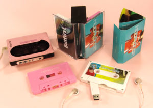 A creative double butterfly case set containing a baby pink audio cassette and white USB cassette drive with additional content