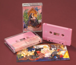 A set of baby pink cassettes with white on-body printing