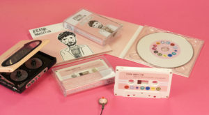 A matching set of white cassettes and white vinyl CDs in digipaks