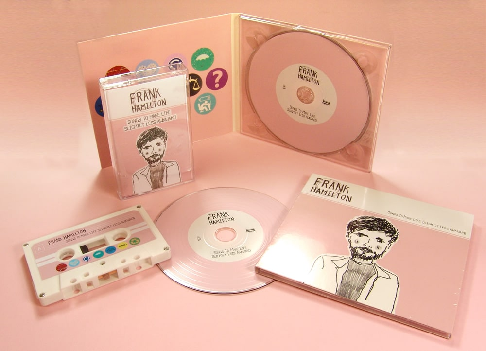 A custom vinyl CD in a four page digipak with a custom pink vinyl effect print on glass mastered discs and matching cassettes