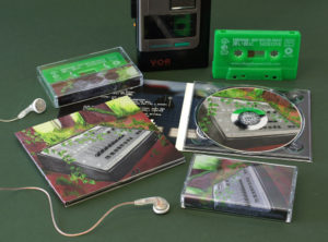 A matching set of green cassettes with white on-body printing and CDs in digipaks