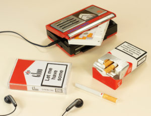 White cassettes in a clear cassette cases with Marlboro-style J-cards