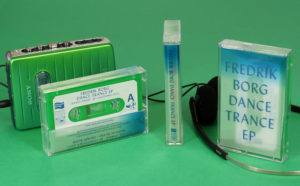Green cassettes in clear shells that use tracing paper J-cards for a frosted semi-transparent effect