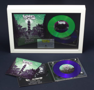 A4 white frame with digipak cover, green vinyl CD and printed plaque