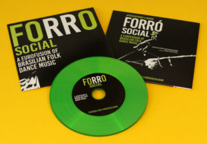 Green vinyl CDs in standard printed card wallets