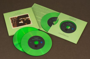 A set of two green vinyl CDs in our 4 page double disc record-style wallets