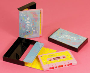 A set of baby pink cassettes in black cases with J-cards