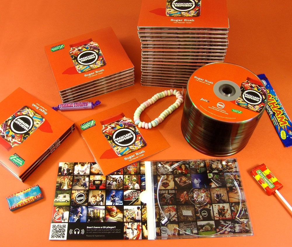 Production of four page digipaks with 12 page booklet and silver base discs