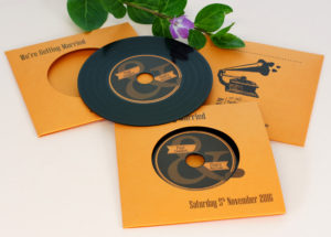 Record-style CD wallet wedding invitations with black vinyl CDs