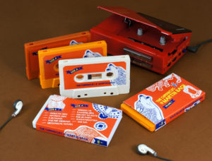 A set of white, yellow and retro orange cassettes in full colour printed O-cards
