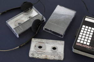Silver glitter cassettes with J-cards printed on a silver metallic cardstock