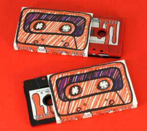 Our black and red sandwich cassettes with hand-drawn style stickers and O-cards