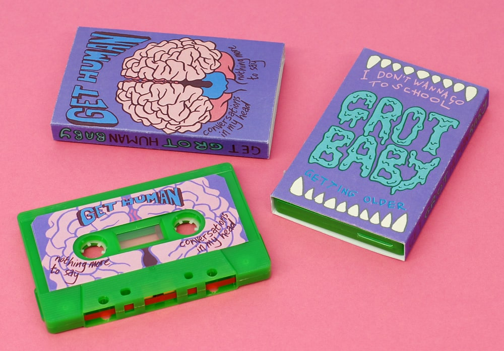 A split cassette for two different punk pop bands Get Human and Grotbaby-baby