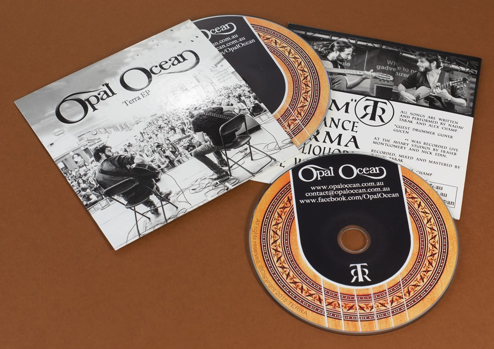 Offset litho printed CDs in card wallets with a gloss UV coating