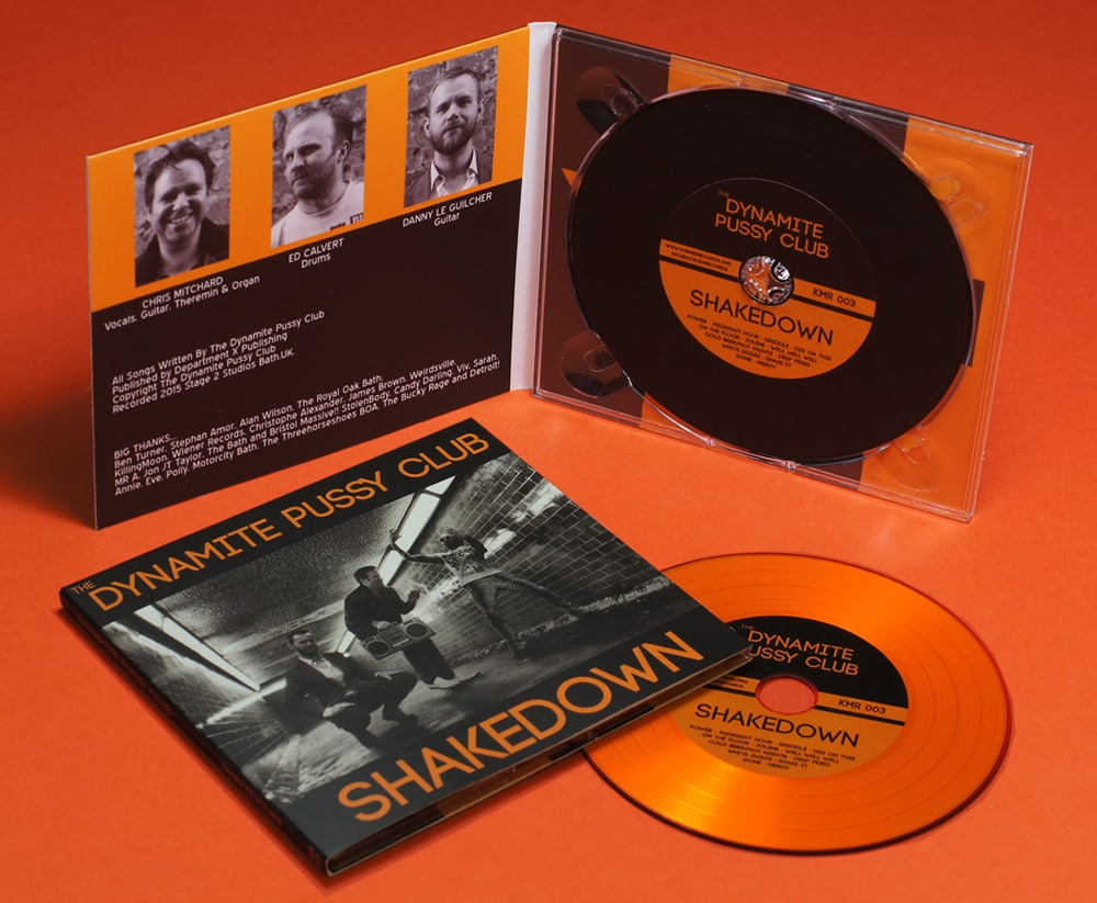 A set of mixed orange and black vinyl CDs in matt laminated 4 page digipaks