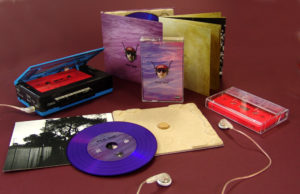 A matching set of purple vinyl CDs in recycled eco digipaks with neon pink cassettes