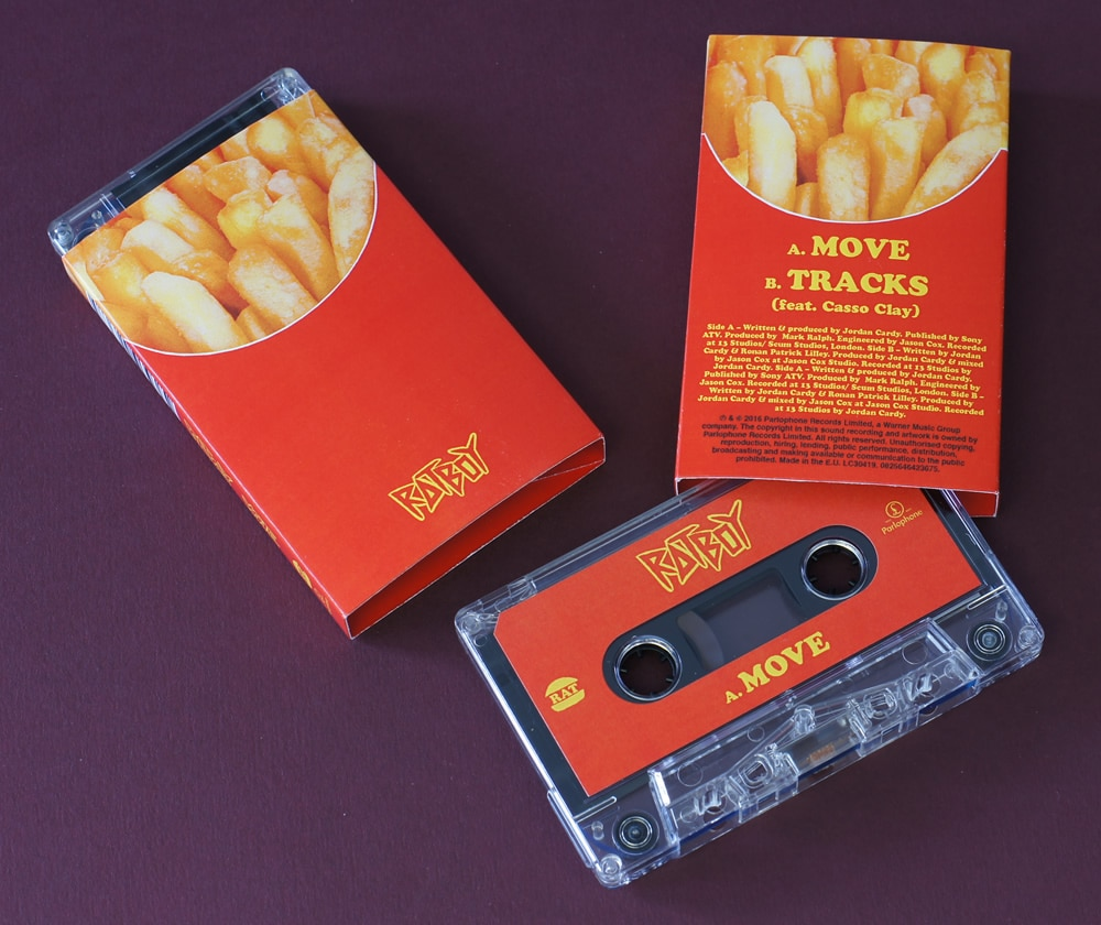 Clear cassettes in French fries O-cards for the 'Move' single release by Rat Boy