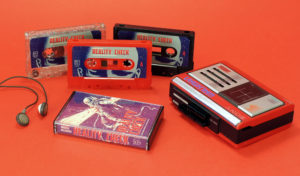 A set of red, black and silver,red and green glitter cassettes with J-cards and black back cases