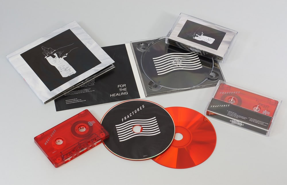 A matching set of transparent red cassettes and red base CDs  in 4 page digipaks