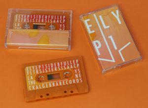 Retro orange cassettes with full colour stickers in clear cassette cases with a full colour printed J-card