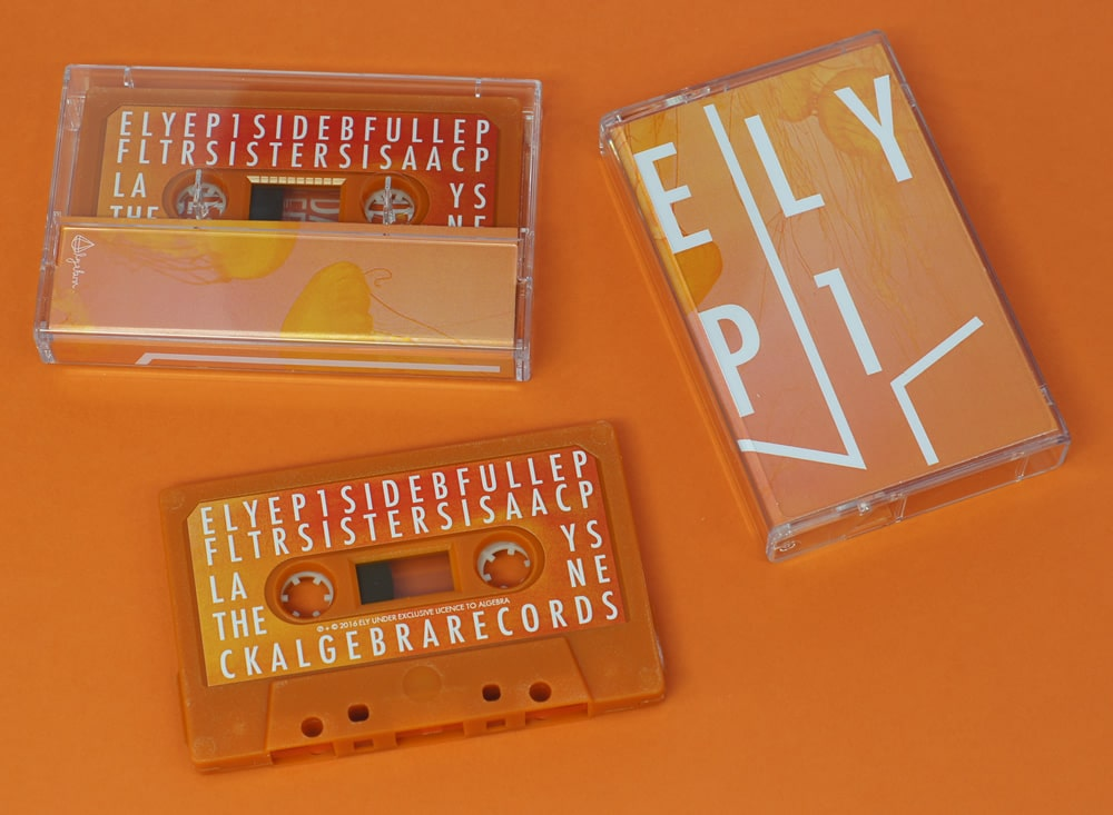 Retro orange cassettes with full colour stickers in clear cassette cases with a full colour printed J-card
