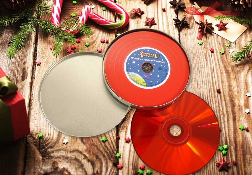 A red vinyl CD with full colour printing, supplied in a metal CD tin with foam insert