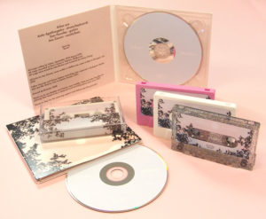 A matching set of CDs in digipaks with pink, white and glitter cassettes